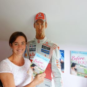 Kathryn Freeman gets help from racing driver Jenson Button